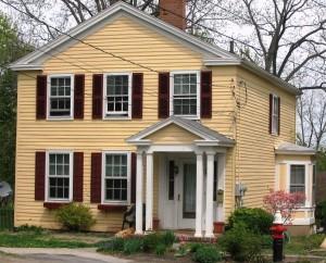 yellow multi-story house