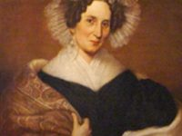 Painting of a woman with a shawl and frilly white cap.