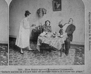 A man and woman sit at a table of food with horrified expressions on their faces. A stands at the table in a nightgown. The caption reads: How Biddy served tomatoes undressed.