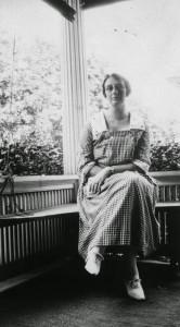 katherine-gracey-sitting-on-a-porch