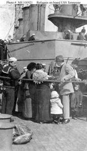 people-standing-of-the-deck-of-a-steamship