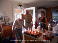 man-blowing-out-candles-on-cupcakes-at-party