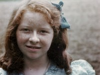 1940s-picture-of-a-girl-with-red-hair-in-a-light-blue-dress