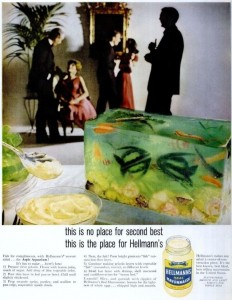 table-with-bowl-of-mayonnaise-and-a-cube-of-green-gelatin-with-vegetables-cut-to-look-like-fsih
