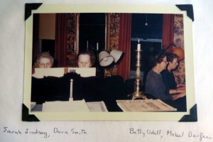 Colored photograph of four women playing pianos.