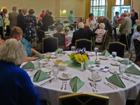 people-sitting-at-tables-at-2015-annual-dinner