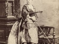 camille-urso-posed-with-her-violin