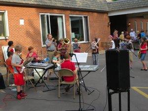 outdoor concert by a youth jazz band