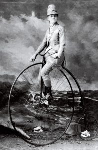 young woman on a bicycle