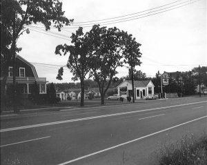 a home and tourists cabins alongside a road