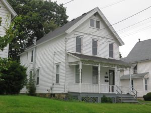 side view of a mutli-story home with a porch