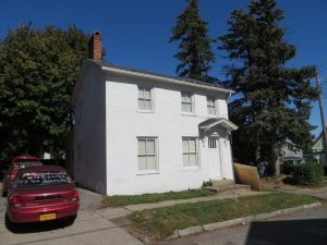 white, multi story house