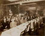 men-seated-around-a-banquet-table