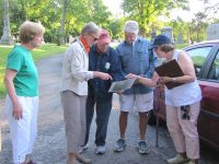people-looking-at-map-in-a-cemetery