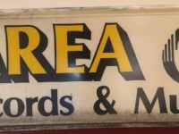 outdoor sign for Area Records and Music