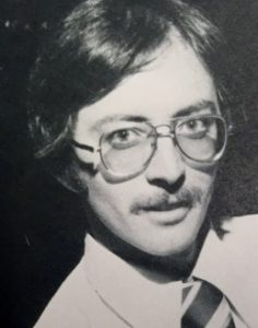 man with a glasses and a mustache