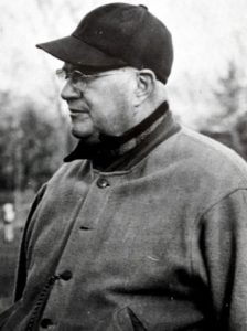 older man in a baseball cap and jacket