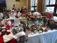 Christmas decorations arranged on tables