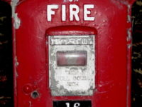Red metal box that served as a fire alarm pull box.