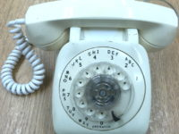 White plastic rotary dial desk phone
