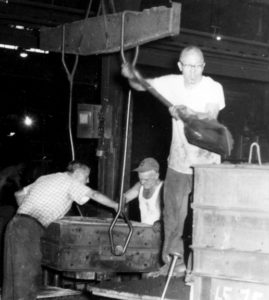 Men In White T Shirts Working In a Factory 1950