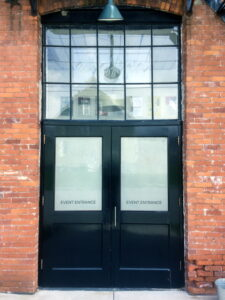 Brick Building Black Doors Event Entrance