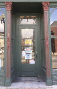 Decorative Entrance with Green Door and Warning Signs