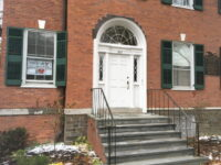 Brick Building With Raised Steps And White Door