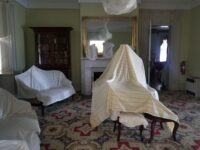 furniture in the Back Parlor of Rose Hill Mansion covered with sheets