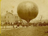 Photo of a balloon inflated at the corner of Genesee and Lewis Streets in May 1874