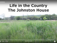 View of green fields and title Life in the Country: The Johnston House