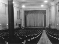 View of the rows of seats and the movie screen at Regent Theater
