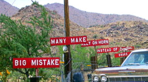 Series of red Burma Shave signs: Big Mistake Many Make Rely on Horn Instead of Brake.