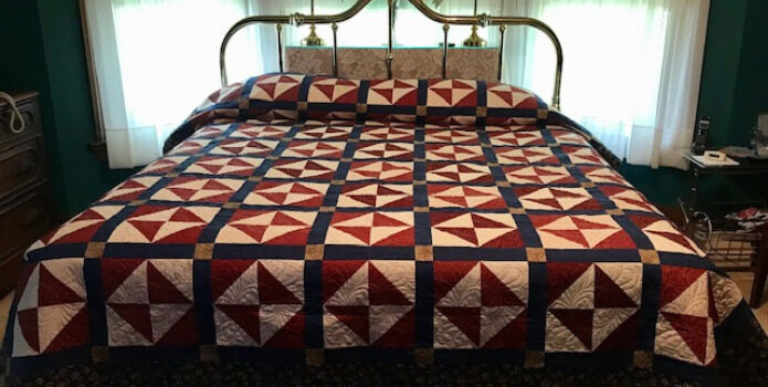 Broken Dishes Quilt on a bed