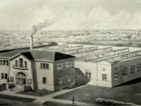 Two Story Building With Factory Circa 1935